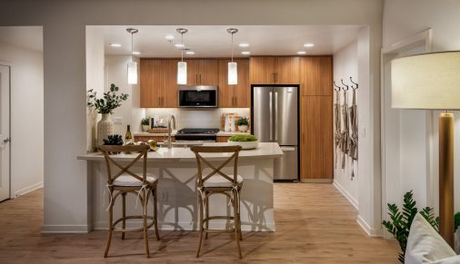Interior view of kitchen at Delrey at The Village at Irvine Spectrum Apartment Homes in Irvine, CA.