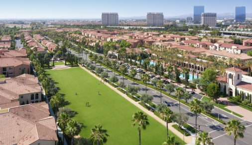 Aerial view of people at courtyard at Los Olivos at Irvine Spectrum Apartment Homes in Irvine, CA.