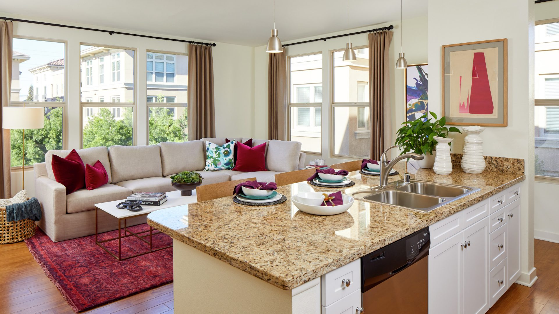 Interior view of Kitchen and Living Room at Crescent Village Apartment Homes in San Jose, CA.
