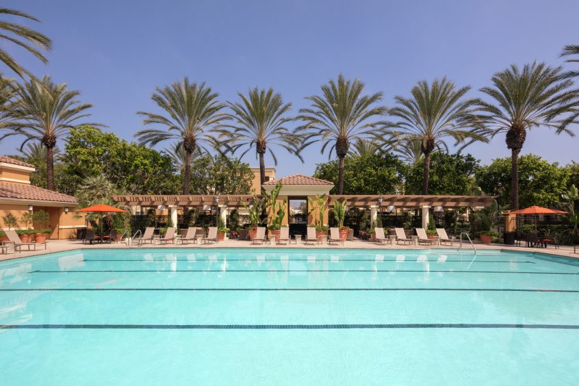 Exterior view of pool at Las Palmas Apartment Homes in Irvine, CA.