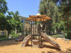 Exterior view of children's play area at Las Palmas Apartment Homes in Irvine, CA.