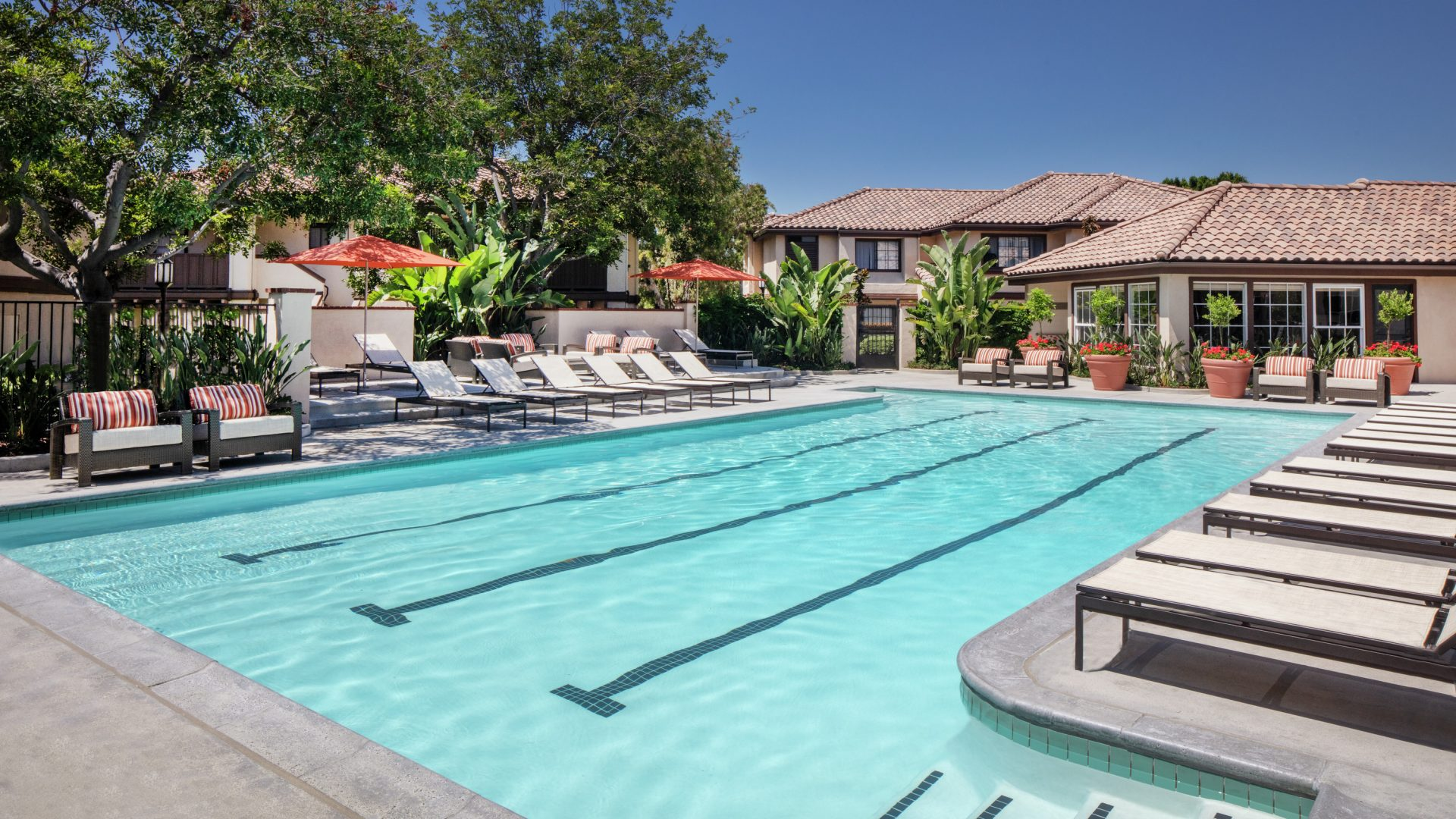 Exterior view of pool at Rancho Tierra Apartment Homes in Tustin, CA.